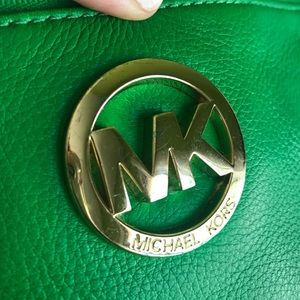 Micheal Kors wristlet in green with gold